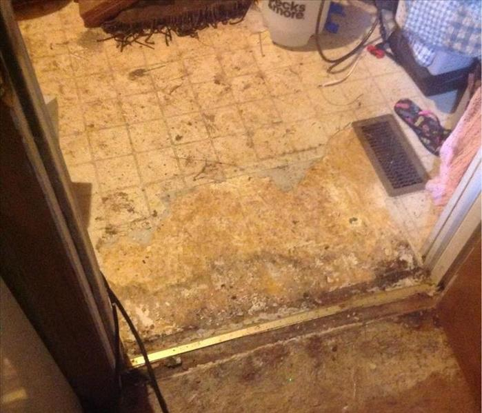 Water damage to floors in laundry room