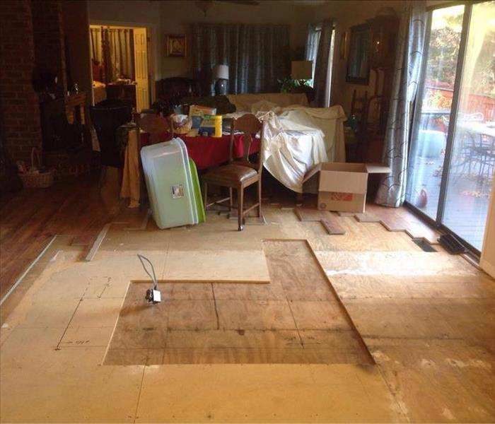 Floors damaged by water from storm